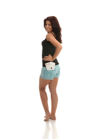 A pretty sexy lady with Poker of Aces in her rear pocket Stock Photo - 16598234