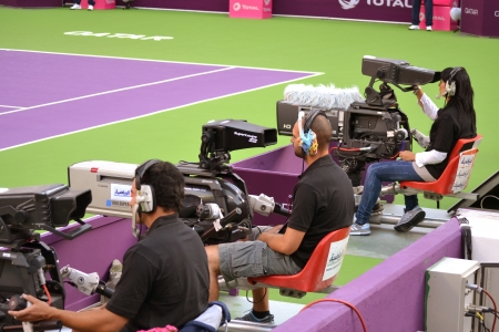 DOHA-QATAR: FEBRUARY 11: Aljazeera Sports Cameramen covering live Qatar Total Open on February 11, 2013 in Doha, Qatar. The event was held from February 11th till February 17th 2013. Stock Photo - 18080192