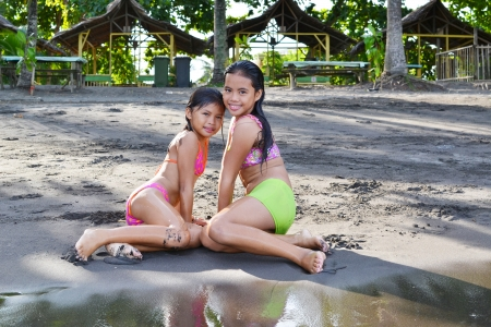 little girl barefoot: Two young girls posing after going out of the water