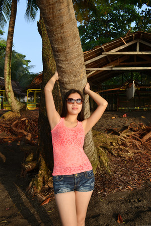 Asian beauty enjoying the sunshine on a tropical island photo