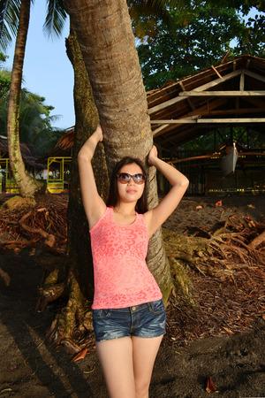 Asian beauty enjoying the sunshine on a tropical island Stock Photo
