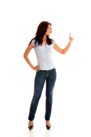 Pretty business lady pointing left up with her finger on a white background Stock Photo