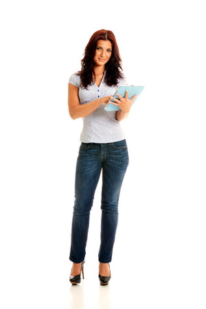 Beautiful business woman working on an electronic device Stock Photo