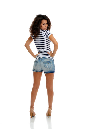 Beautiful fashion brunette posing in summer casual clothes