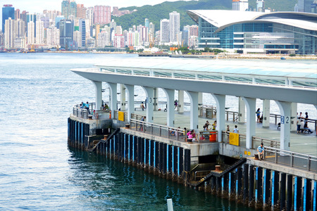HONG KONGCHINA - MAY 25: Ferry boat harbor in downtown Hong Kong on May 25th 2014. Central Pier station is one of the main maritime local transportation in Hong Kong.