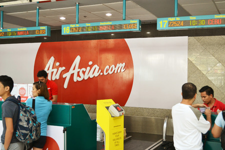 DAVAO PHILIPPINES  APRIL 19 2015: Air Asia flights check in at Davao International airport. Air Asia is one of the most popular flying agencies in the Philippines and the far east.