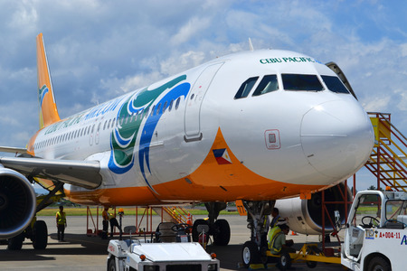 DAVAO PHILIPPINES  APRIL 19 2015: Cebu Pacific aircraft at Davao International Airport. Cebu Pacific is one of the most popular Filipino flying agencies in the Philippines and the neighboring countries.