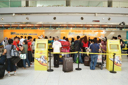 DAVAO PHILIPPINES  APRIL 19 2015: Cebu Pacific flights check in at Davao International Airport. Cebu Pacific is one of the most popular Filipino flying agency in the Philippines.
