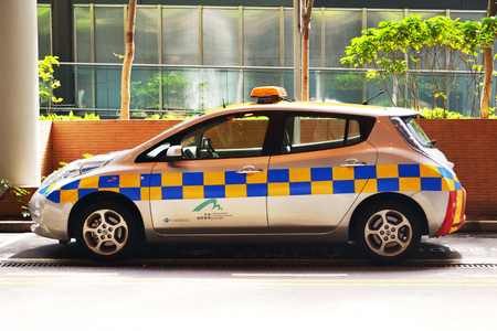 Hong Kong, China - May 25, 2014: Hong Kong airport security vehicle parking outside the airport. Hong Kong airport is one of the busiest airports in the world.