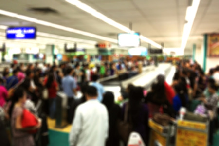 Blurred background of busy baggage claim area at an international airport