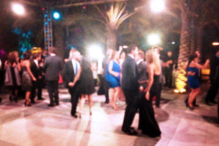 wedding party: Blurred background of night dancing party outdoor Stock Photo