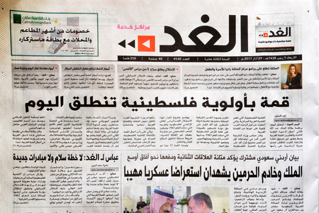 Amman, Jordan - March 29, 2017: Jordanian daily newspaper Alghad, Tomorrow in Arabic, announcing the start of the 28th Arabic summit in Jordan. Alghad is one of the official newspapers in Jordan since 2004.