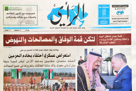 Amman, Jordan - March 29, 2017: Jordanian daily newspaper Alrai, the opinion in Arabic, announcing the start of the 28th Arabic summit in Jordan. Alrai is one of the oldest and official newspapers in Jordan since 1971. Editorial