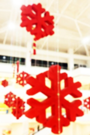 Colorful blurred background of Christmas decoration pending from the ceiling of a shopping center Stock Photo