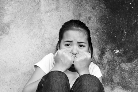 Asian teenager with trauma sitting in an abandoned place Stock Photo