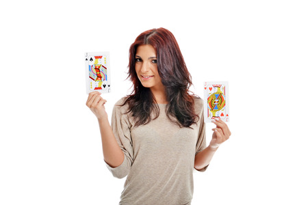 Beautiful lady showing two big playing cards Stock Photo