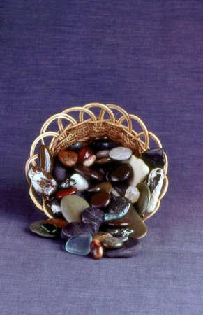 Polished rocks in basket . Banco de Imagens