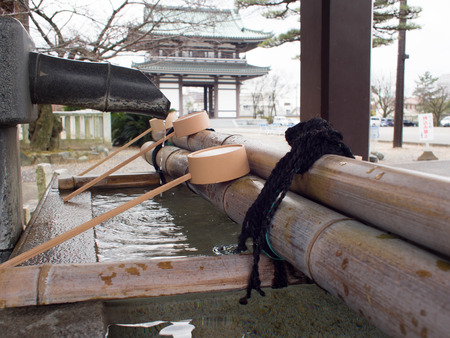 purification: Water purification at entrance of the Japanese temple