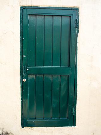 doorhandle: Green closed door Stock Photo
