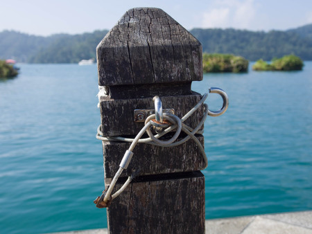 Rope attach to dock post Stock Photo