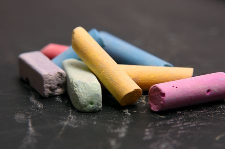 Colour school chalk on a black board Stock Photo