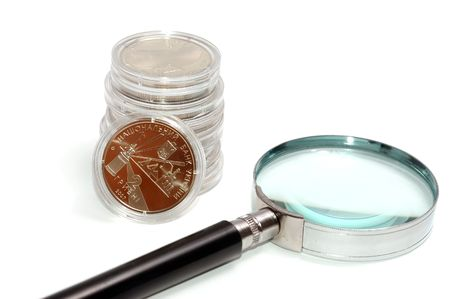Money under a magnifier on the white Stock Photo - 5621463