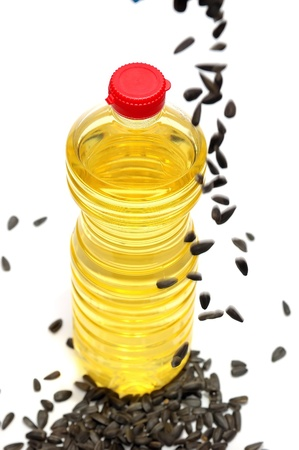 sunflowerseed: Bottle with sunflower-seed oil and sunflower seeds on a white background Stock Photo