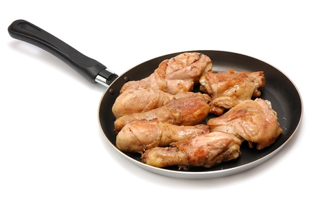 Roast chicken on a frying pan on a white background Stock Photo