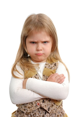 children sad: The angry little girl on a white background Stock Photo