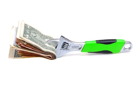 Wrench with money on a white background