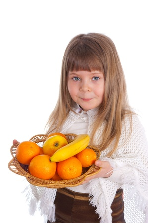 The little girl with fruit on a white background