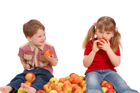Children with apples on a white background