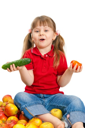 The little girl with fruit and vegetables isolated on white background