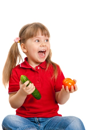 The girl with vegetables on the white