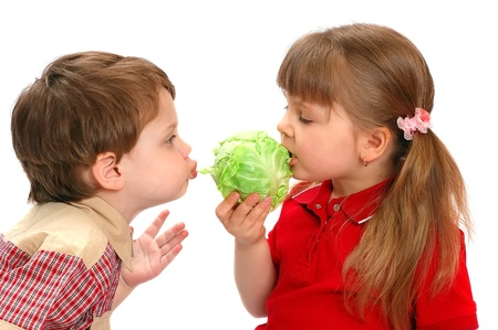 Childrens eat cabbage on a white background Stock Photo