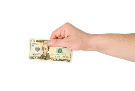 Mans hand with a banknote. Isolated on white