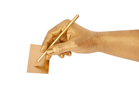 Mans golden hand writes on cut-away by a pencil. Isolated on the white