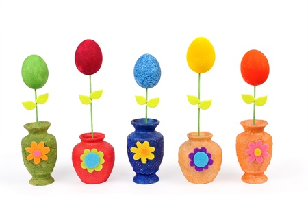 Colourful Easter eggs in vases. Isolated on the white  photo