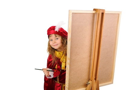 The girl with a brush near an easel. Isolated on white photo