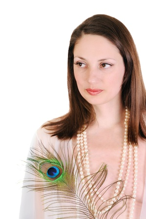 Portrait of a young woman with a peacock feather. Isolated on white  photo