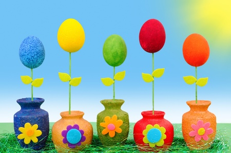 Colourful Easter eggs in vases photo