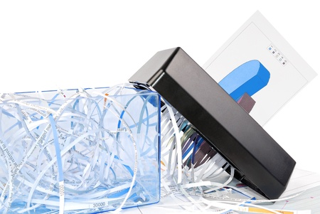shredder machine: Shredder destroys the document