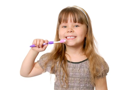 Girl has control over a tooth-brush. Isolated on white photo