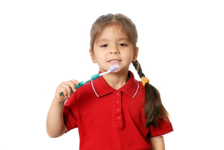 Girl has control over a tooth-brush. Isolated on white  Stock Photo