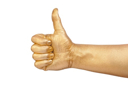 geste: Mans golden hand shows sign OK  Stock Photo