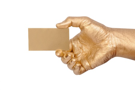 geste: Mans golden hand holding an empty business card over white background  Stock Photo