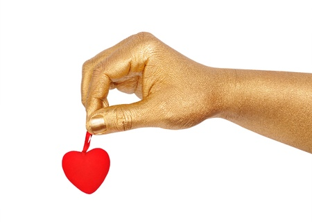 geste: Mans golden hand with a red heart over white background