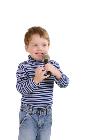 Little boy with a microphone. Isolated on white  photo