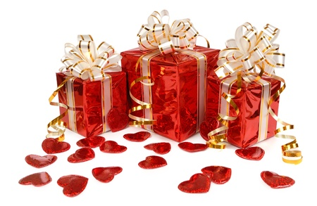 Three red gift box and hearts isolated on white background  photo