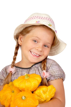 The little girl with bush pumpkins. Isolated over white  Stock Photo